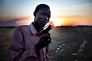 A man holds a toy gun in the disputed border area of Abyei weeks before it was overun by the Northern army.