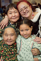 Four Generations of CUP'IK doll makers: Rusalie Paniyak (Lower left); Ursula Paniyak-Irvin (Upper left); Janice Tamang (Upper right) and Jaderiane Paniyak (Lower right), at the Alaska Federation of Natives craft fair, Anchorage