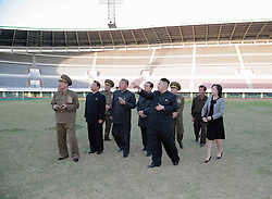 59584164  .The photo provided by KCNA on April 30, 2013 shows top leader of the Democratic People s Republic of Korea (DPRK) Kim Jong Un (R Front), accompanied by his wife Ri Sol Ju (1st R), visiting the Yanggakdo Stadium in Pyongyang, capital of the DPRK, on April 29, 2013, 30, April 2013. Photo by: i-Images.UK ONLY