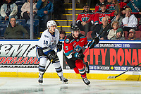 KELOWNA, BC - NOVEMBER 6: Logan Doust #10 of the Victoria Royals is checked by Cayde Augustine #5 of the Kelowna Rockets at Prospera Place on November 6, 2019 in Kelowna, Canada. (Photo by Marissa Baecker/Shoot the Breeze)