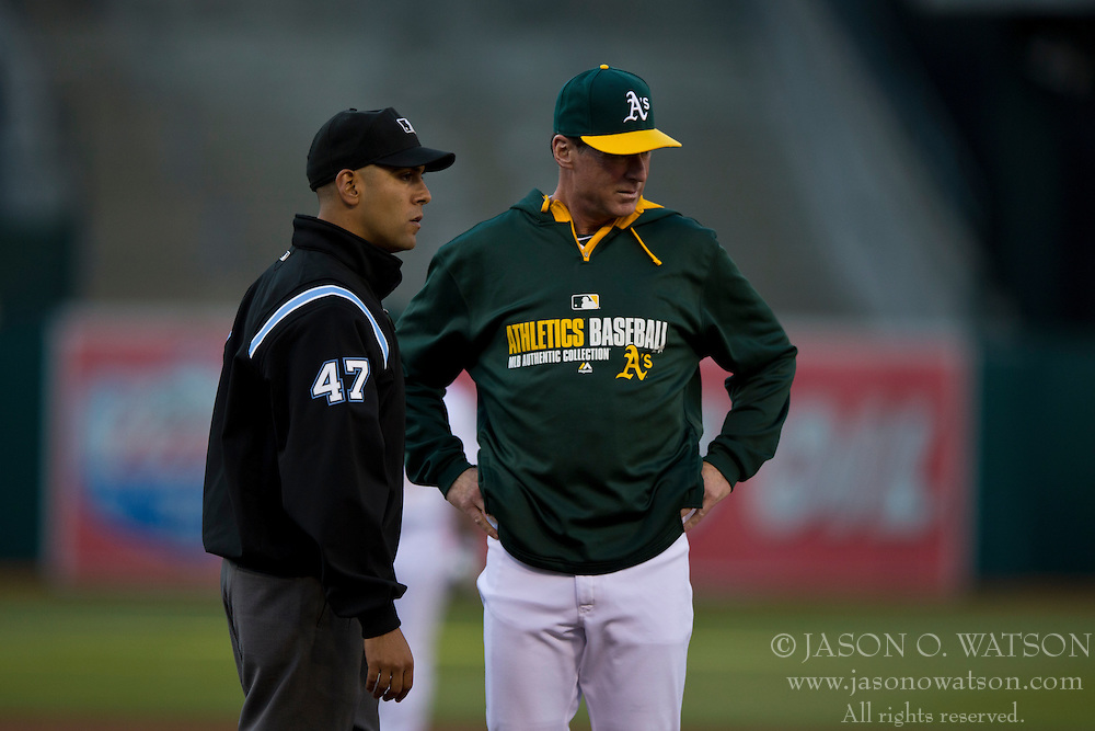 OAKLAND, CA - JULY 05:  Bob Melvin #6 of the Oakland Athletics talks to umpire Gabe Morales #47 during the first inning against the Toronto Blue Jays at O.co Coliseum on July 5, 2014 in Oakland, California. The Oakland Athletics defeated the Toronto Blue Jays 5-1.  (Photo by Jason O. Watson/Getty Images) *** Local Caption *** Bob Melvin; Gabe Morales