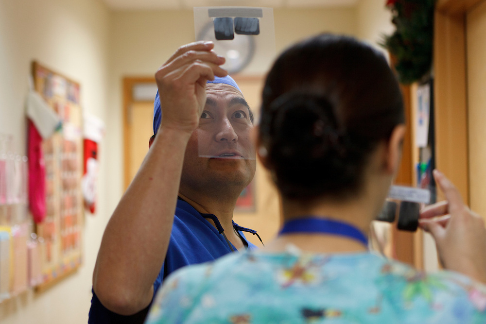 Peter Chiang, D.D.S., looks at x-rays Tuesday, Dec. 13, 2011, at Central Coast Pediatric Dental Group in Salinas, California.