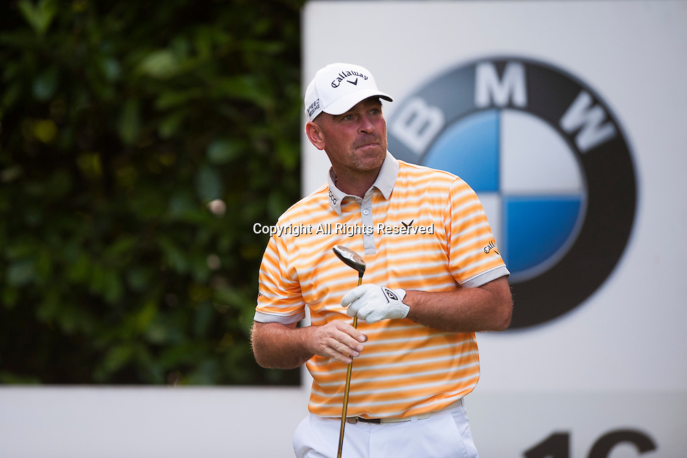 23.05.2014. Wentworth, England.   Thomas BJORN [DEN] tees off on the 16th during the second round of the 2014 BMW PGA Championship from The West Course Wentworth Golf Club