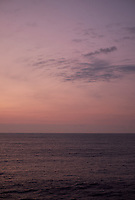 Pastel colored sky and clouds over the Pacific Ocean at dawn.  Image 14 of 21  for a panorama taken with a Fuji X-T1 camera and 35 mm f/1.4 lens  (ISO 400, 35 mm, f/2.8, 1/30 sec). Raw images processed with Capture One Pro and stitched together with AutoPano Giga Pro.