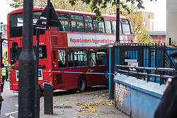 Ladbroke Grove, London, November 17th 2016. A double decker bus crashes into Kensal House on Ladbroke Grove prompting a major response from the emergency services including the air ambulance. According to Detective Chief Superintendent Ellie O'Connor of Met Police Kensington and Chelsea, 14 people including the driver were hurt, with none sustaining life-threatening or life changing injuries. Police officers would not speculate on the cause of the accident, but apologised for delays and commended all branches of the emergency services for their prompt and efficient response. The bus will be towed away for further investigations. PICTURED: The bus crashed into the entrance of Kensal House, a residential apartment block.