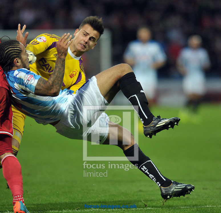 Sean Scannell of Huddersfield Town collides with Karl Darlow of Nottingham Forest during the Sky Bet Championship match at the John Smiths Stadium, Huddersfield<br /> Picture by Graham Crowther/Focus Images Ltd +44 7763 140036<br /> 01/11/2014