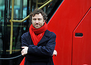 © Licensed to London News Pictures. 16/12/2011, London, UK.  The bus's designer Thomas Heatherwick. The first bus designed specifically for London arrived in the capital today, carrying the Mayor of London BORIS JOHNSON. The bus design is based on the famous red route master buses with a rear platform for access. Photo credit : Stephen Simpson/LNP