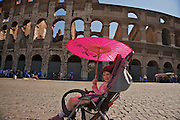 Respite from the sun.  A young girl (my daughter Erin) on tour in Rome.
