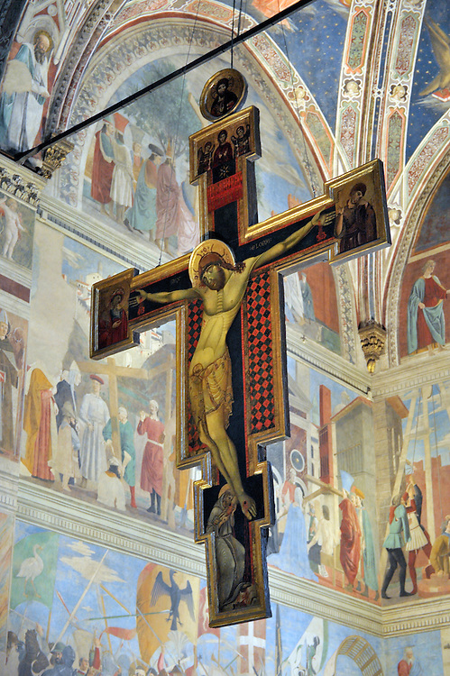 Arezzo, Italy. Church of San Francesco. 12 C. crucifix by Master of San Francesco in front of mural Legend of the True Cross