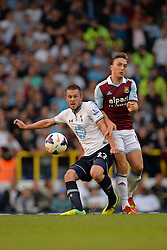 Tottenham Hotspur's Gylfi Sigurosson and West Ham United's Mark Noble compete for the ball - Photo mandatory by-line: Mitchell Gunn/JMP - Tel: Mobile: 07966 386802 06/10/2013 - SPORT - FOOTBALL - White Hart Lane - London - Tottenham Hotspur V West Ham United - Barclays Premiership