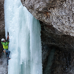 Erik Welborn ice climbing a rarely formed 3 pitch, Unnamed route, WI4 beside High on Boulder in Cody, WY