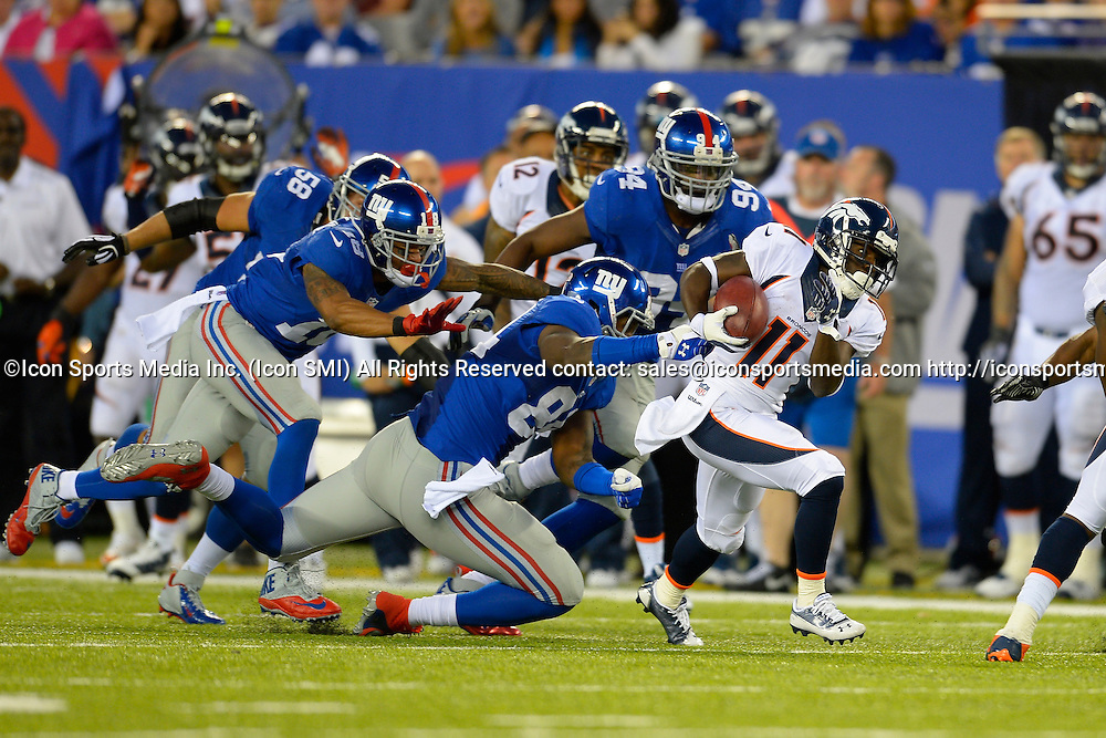 September 15, 2013: Denver Broncos wide receiver Trindon Holliday (11) runs back a 81 yard punt return during the second half of a week 2 NFL matchup between the Denver Broncos and the New York Giants at MetLife Stadium is East Rutherford NJ. The Broncos defeated the Giants 41-23.