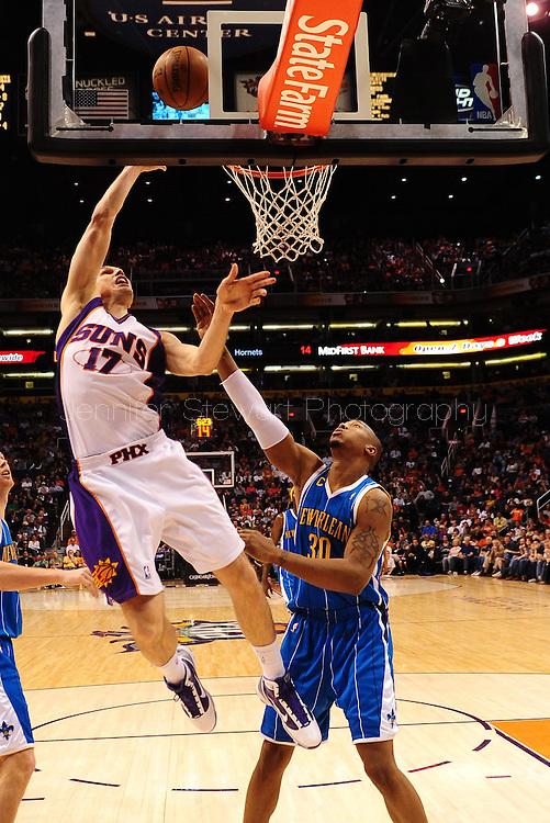 Mar. 14 2010; Phoenix, AZ, USA; Phoenix Suns center Louis Amundson (17) puts up a shot against New Orleans Hornets forward David West (30) in the first half at the US Airways Center. Mandatory Credit: Jennifer Stewart-US PRESSWIRE.