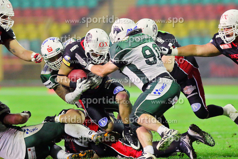 11.10.2014, Friedrich Ludwig Jahn Sportpark, Berlin, GER, SPO, German Bowl XXXVI, Schwaebisch Hall Unicorns vs 1. FFC Braunschweig, im Bild Sven Rosemann (1. FFC Braunschweig) wird von Albert Langebartels (Schwaebisch Hall Unicorns) gestoppt // SPO during the German Bowl XXXVI between Schwaebisch Hall Unicorns and 1. FFC Braunschweig at the Friedrich Ludwig Jahn Sportpark in Berlin, Germany on 2014/10/11. EXPA Pictures &copy; 2014, PhotoCredit: EXPA/ Eibner-Pressefoto/ Hundt<br /> <br /> *****ATTENTION - OUT of GER*****