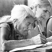 San Salvador, El Salvador 1982.<br /> Displaced women learn to read &amp; write for the first time in a safe refuge.