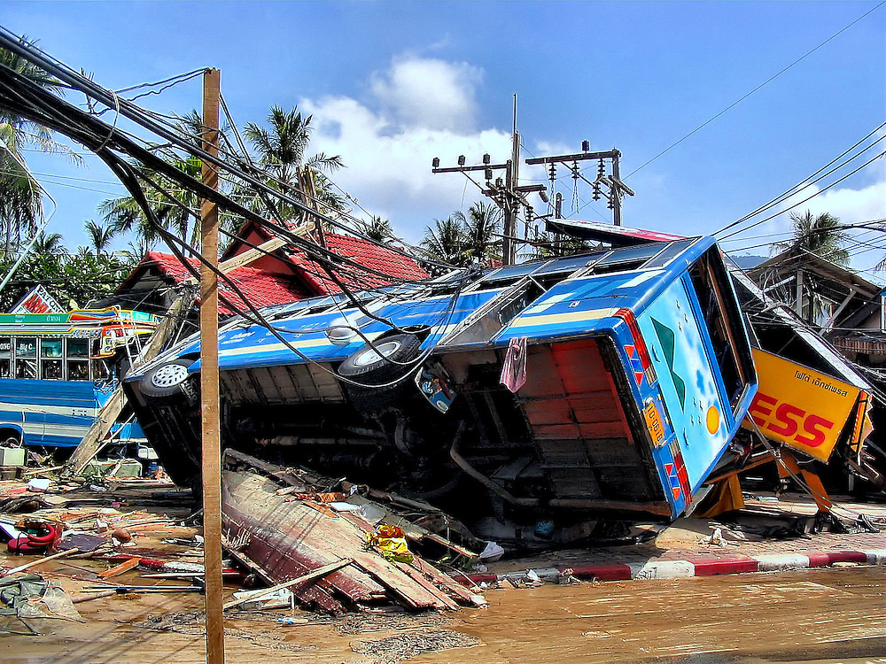 Overturned Bus After Tsunami on Patong Beach in Phuket, Thailand <br />
