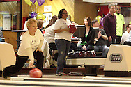 (from left) Julie Roettker of Cincinnati and Amber Hyman of Middletown during Bowl for Kids' Sake at Poelking Woodman Lanes in Dayton, Saturday, March 16, 2013.