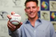 Kyle Glogoski holds a baseball he signed.<br /> Kyle Glogoski at the Philadelphia Phillies signing ceremony held at Lloyd Elsmore Park, Pakuranga, Auckland, New Zealand. 4 January 2018. &copy; Copyright Image: Marc Shannon / www.photosport.nz.