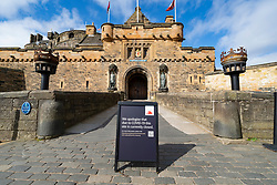 Edinburgh, Scotland, UK. 18 April 2020. Views of empty streets and members of the public outside on another Saturday during the coronavirus lockdown in Edinburgh. Edinburgh Castle is closed during the pandemic. Iain Masterton/Alamy Live News