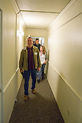 Tom and Melanie Birchler talk to their tour guide Michael Galloway as they walk down the hall of Cady Hall reminiscing about when Tom lived on south green in 1981.