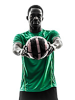 one african man soccer player green jersey holding showing football in silhouette on white background