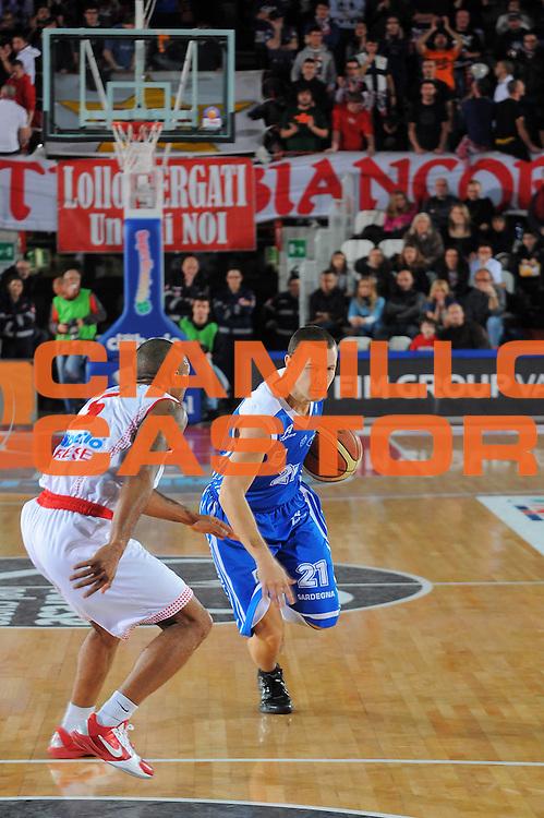 DESCRIZIONE : Varese Lega A 2010-11 Cimberio Varese Dinamo Sassari<br /> GIOCATORE : Mauro Pinton<br /> SQUADRA : Dinamo Sassari<br /> EVENTO : Campionato Lega A 2010-2011<br /> GARA : Cimberio Varese Dinamo Sassari<br /> DATA : 06/01/2011<br /> CATEGORIA : Palleggio<br /> SPORT : Pallacanestro<br /> AUTORE : Agenzia Ciamillo-Castoria/A.Dealberto<br /> Galleria : Lega Basket A 2010-2011<br /> Fotonotizia : Varese Lega A 2010-11Cimberio Varese Dinamo Sassari<br /> Predefinita :