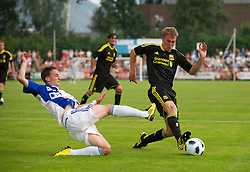 ZUG, SWITZERLAND - Wednesday, July 21, 2010: Liverpool's Stephen Darby in action against Grasshopper Club Zurich during the Reds' first preseason match of the 2010/2011 season at the Herti Stadium. (Pic by David Rawcliffe/Propaganda)