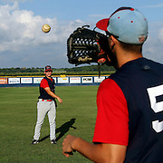 Grant Clyde, left, plays catch with Steven Greenberg prior to the Clarinda A's home game against the Omaha Diamond Spirit at Municipal Stadium in Clarinda.  photo by David Peterson
