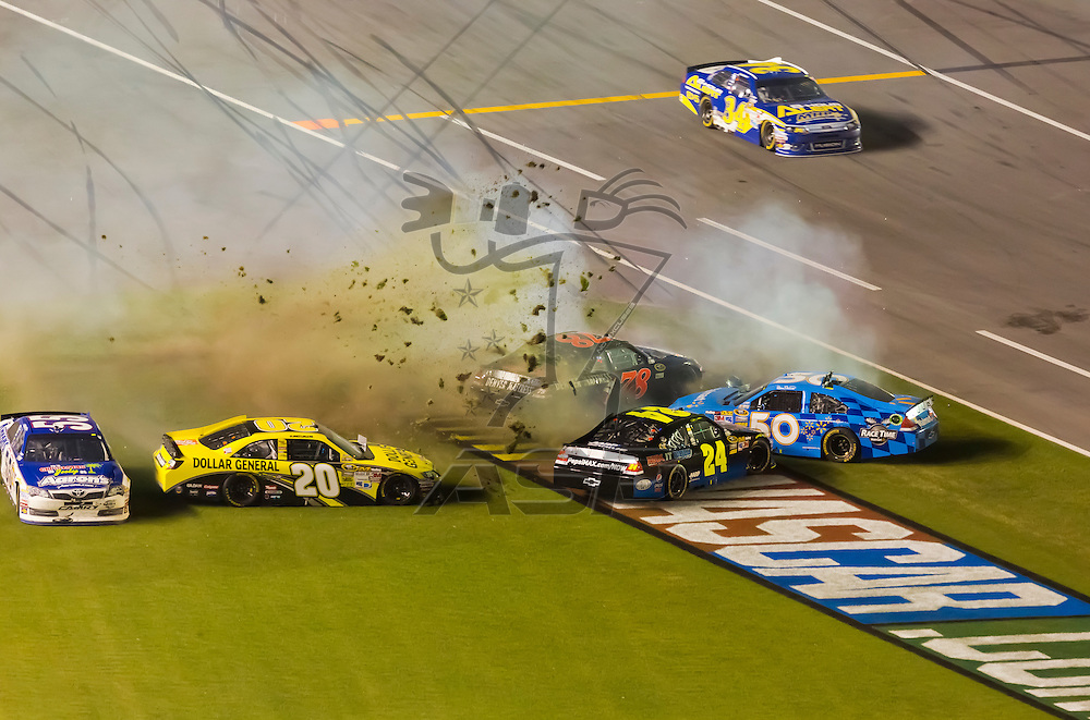 DAYTONA BEACH, FL - JUL 07, 2012:  The field crashed through the fronstretch during the Coke Zero 400 at the Daytona International Speedway in Daytona Beach, FL.