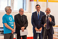 ROME, ITALY - JUNE 19: Michel Roy, Secretary General of Caritas Internationalis, Mgr Enrico Feroci, Director of Caritas Rome and Oliviero Forti, Head of Migration at Caritas Italiana during the Day of Refuge, at the 'San Giovanni Paolo II' canteen in Via Marsala, the diocesan Caritas of Rome organized 'The Meal of the Meeting', with migrants and refugees to share the migratory experience. This is part of the awareness campaign 'Share the Journey' promoted by Caritas Internationalis and launched by Pope Francis on 27 September last on June 19, 2018 in Rome, Italy.