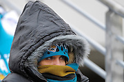 A Jacksonville Jaguars bundles up from the cold during the Washington Redskins 20-17 overtime win at EverBank Field on Dec. 26, 2010 in Jacksonville, Fl. Temperatures were in the low 30s with wind chills in the low 20s during the game. ©2010 Scott A. Miller