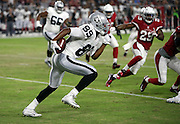 Oakland Raiders wide receiver Amari Cooper (89) catches a flat pass and runs for a 6 yard gain on the Raiders second drive of the first quarter during the 2016 NFL preseason football game against the Arizona Cardinals on Friday, Aug. 12, 2016 in Glendale, Ariz. The Raiders won the game 31-10. (©Paul Anthony Spinelli)
