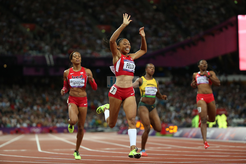 Allyson Felix celebrates after winning the 200m final during track and field at the Olympic Stadium during day 12 of the London Olympic Games in London, England, United Kingdom on August 8, 2012..(Jed Jacobsohn/for The New York Times)..