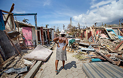 An elderly woman walks along a debris filled street in Roche a Bateau, Haiti, on October 9, 2016. Photo by Patrick Farrell/Miami Herald/TNS/ABACAPRESS.COM
