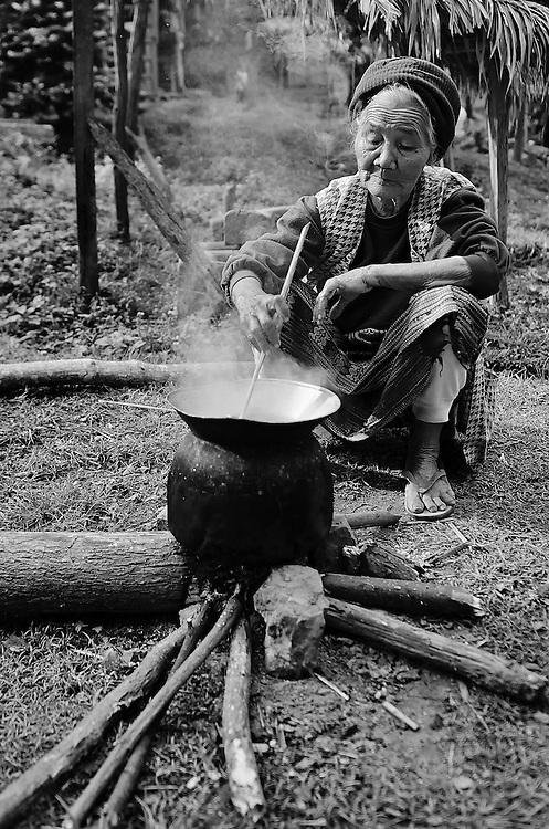 A woman cooking in a village near Hua Xai, Laos.