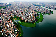 """Aerial view of the slums that cover huge illegally-occupied-areas on the shores of São Paulo's most important fresh-water-reservoir, the """"Represa Billings. São Paulo, São Paulo, Brazil, Wednesday, May 14, 2008."""
