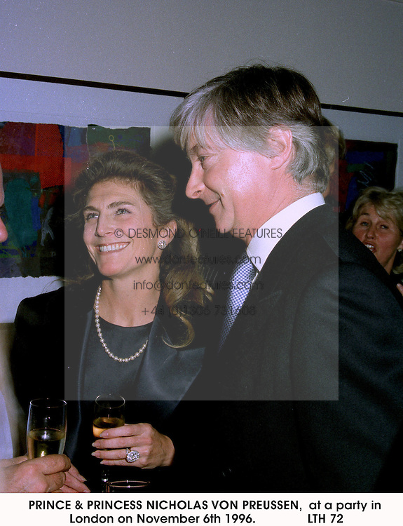 PRINCE & PRINCESS NICHOLAS VON PREUSSEN,  at a party in London on November 6th 1996.LTH 72
