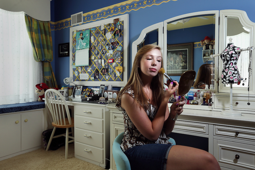 Grand Island Senior High graduate Abbey Foglesong poses for a portrait in her room. Before graduating, Foglesong played flute in the marching band, performed in the orchestra, acted in drama productions, worked as an athletic trainer, qualified for Cornhusker Girls State, volunteered at the library and helped as a teacherís aide for a third grade class. She will be attending the University of Nebraska-Lincoln and hopes to pursue a career in dermatology. (Independent/Matt Dixon)
