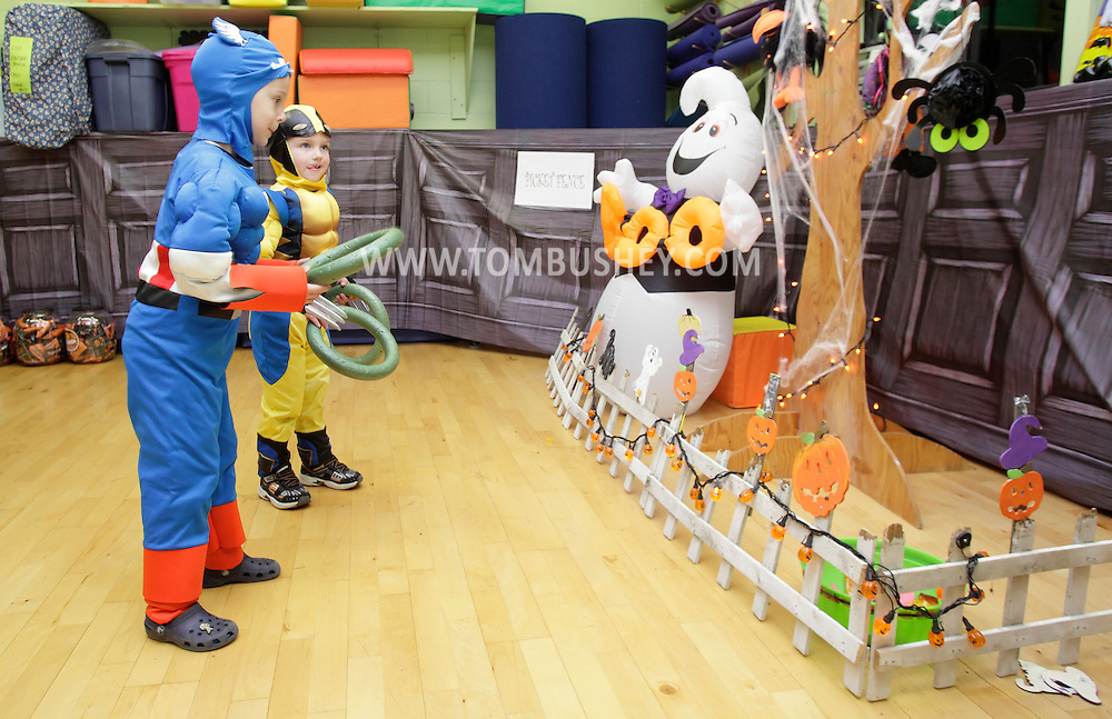 Middletown, New York - Two boys wearing costumes play a game at the Family Fall Festival at the Middletown YMCA on Oct. 23, 2010.