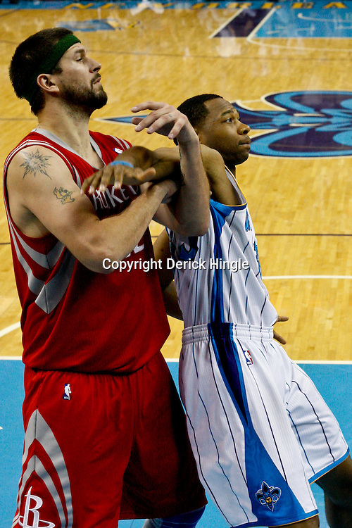 April 6, 2011; New Orleans, LA, USA; Houston Rockets center Brad Miller (52) and New Orleans Hornets shooting guard Willie Green (33) during the second half at the New Orleans Arena. The Hornets defeated the Rockets 101-93 and clinched a playoff spot with the victory.   Mandatory Credit: Derick E. Hingle-US PRESSWIRE