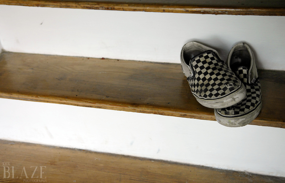Classic Checkered Vans slip-ons on stairwell.