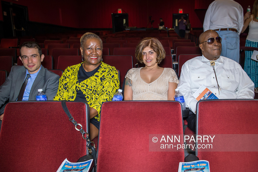 Bellmore, New York, USA. July 16, 2015. R-L, actor JOHN AMOS; ELISABETE DE SOUSA, Co-Founder of Halley's Comet Foundation (HCF); JOHANNA WRIGHT, Board of Education, South Orange, NJ, and Board HCF; and PAUL BALDESSAIRE, Mr. Amos' Manager, are in the Bellmore Movies theater for the LIIFE Awards Ceremony. At the 18th Long Island International Film Expo, Amos was an LIFTF Lifetime Creative Achievement Honoree for his work in films such as ROOTS, and DIE HARD 2, and COMING TO AMERICA. Amos has a fundraising partnership with HCF.