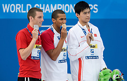 Ryan Cochrane of Canada (L) celebrates the silver medal, Oussama Mellouli of Tunisia (C) the gold medal and Yang Sun of China the bronze medal during the medal ceremony for the Men's 1500m Freestyle Final at the 13th FINA World Championships Roma 2009, on August 2, 2009, at the Stadio del Nuoto,  in Foro Italico, Rome, Italy. (Photo by Vid Ponikvar / Sportida)