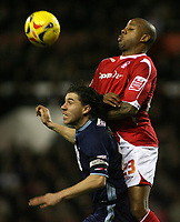 Photo: Paul Thomas.<br /> Nottingham Forest v Leyton Orient. Coca Cola League 1. 16/12/2006.<br /> <br /> Forest's Junior Agogo (R) tries to out jump John Mackie for the ball.
