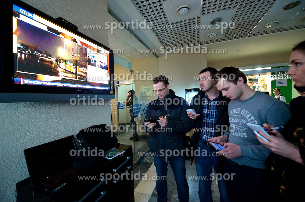 People watch news broadcast at the airport of Rostov-on-Don in southwestern Russia, where the Flydubai Flight 981 crashed, March 19, 2016. A Boeing 737 passenger plane from Dubai crashed early Saturday at the destination airport in southwestern Russia, with all the some 60 people on board feared to have been killed, emergencies authorities and local media reports said. EXPA Pictures &copy; 2016, PhotoCredit: EXPA/ Photoshot/ RIA<br /> <br /> *****ATTENTION - for AUT, SLO, CRO, SRB, BIH, MAZ, SUI only*****