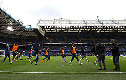 Chelsea players warm up during the Premier League match at Stamford Bridge, London.