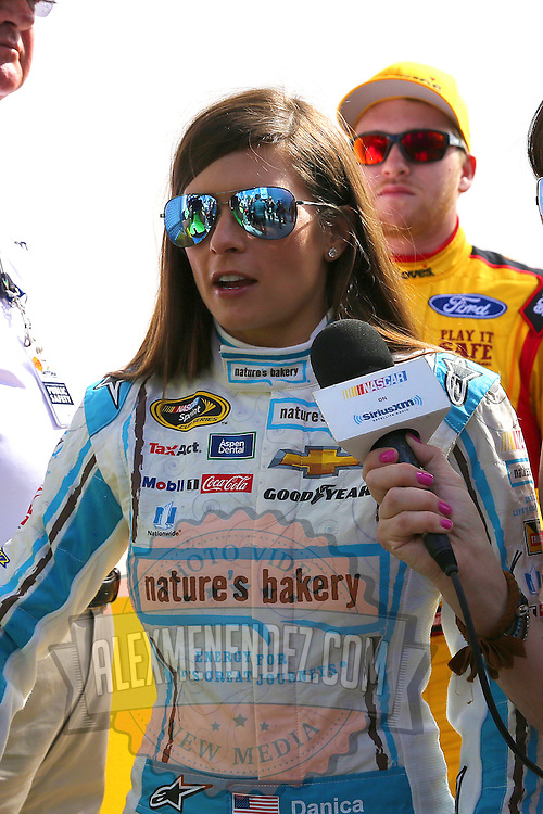 Race car driver Danica Patrick is seen as he makes her way to the drivers meeting prior to the 58th Annual NASCAR Daytona 500 auto race at Daytona International Speedway on Sunday, February 21, 2016 in Daytona Beach, Florida.  (Alex Menendez via AP)