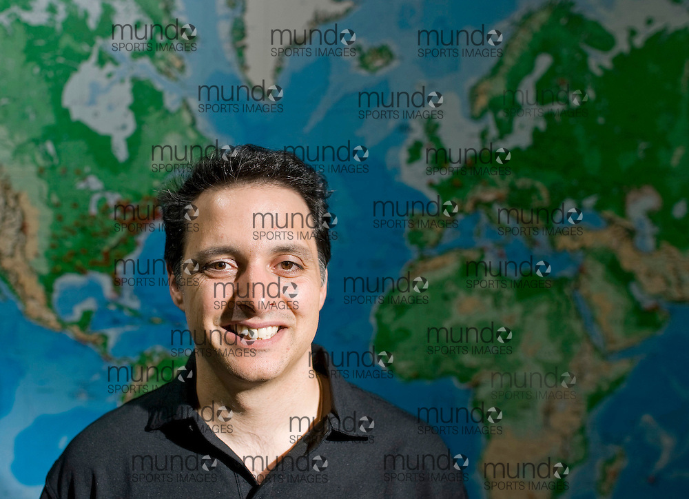 Waterloo, Ontario ---07/09/07---  Sandvine president and CEO David Caputo, stands in front of a large map of the world in the company's offices in Waterloo, Ontario. Sandvine, an broadband networking solutions company is expanding internationally..GEOFF ROBINS The Globe and Mail