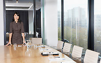 Businesswoman Standing in Conference Room