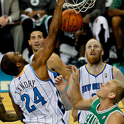 December 28, 2011; New Orleans, LA, USA; New Orleans Hornets power forward Carl Landry (24) dunks over Boston Celtics center Greg Stiemsma (54) during the second half of a game at the New Orleans Arena. The Hornets defeated the Celtics 97-78.  Mandatory Credit: Derick E. Hingle-US PRESSWIRE